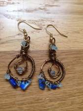 Earrings: bronze plated wire with lapis lazuil and aquamarine