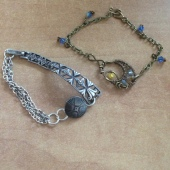 Two bracelets: repurposed watch band and button and wirewoven crescent centerpiece